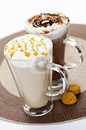 Hot chocolate and coffee beverages stock photo, Hot beverages of coffee and chocolate with whipped cream by Elena Elisseeva