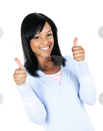 Smiling young woman stock photo, Smiling black woman giving thumbs up gesture isolated on white background by Elena Elisseeva