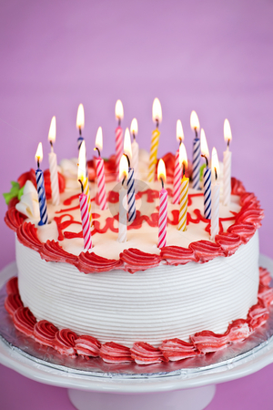 Birthday cake with candles stock photo, Birthday cake with lit candles and white icing by Elena Elisseeva