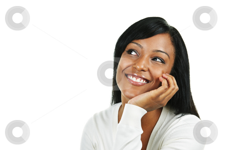 Happy young woman stock photo, Smiling black woman looking up isolated on white background by Elena Elisseeva