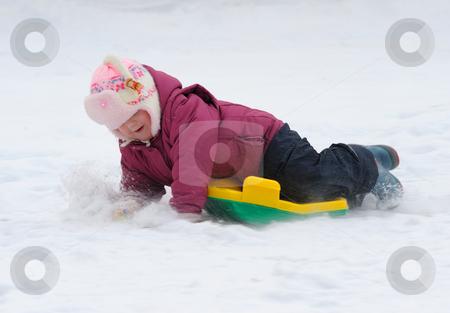 Winter Games Children stock photo, Winter games children - a girl sledding down the hills by Vladimir Blinov