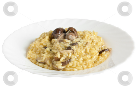 Risotto with porcini mushrooms stock photo, Plate of risotto with mushrooms isolated on white background with clipping path by ANTONIO SCARPI