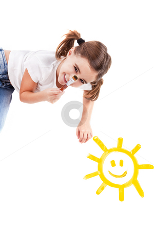 Painting a happy sun stock photo, Top view of a happy girl lying on floor and painting a happy sun by ikostudio