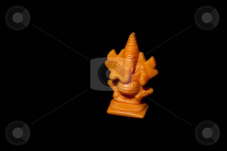Ganesha stock photo, Statue of Indian god isolated on black background by Arvind Balaraman