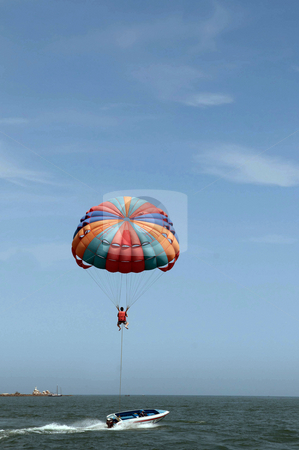 Parasailing stock photo, One man is parasailing over the clean sea. by Arvind Balaraman