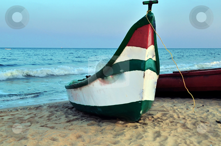 Shore stock photo, A fishing boat parked by the sea shore by Arvind Balaraman