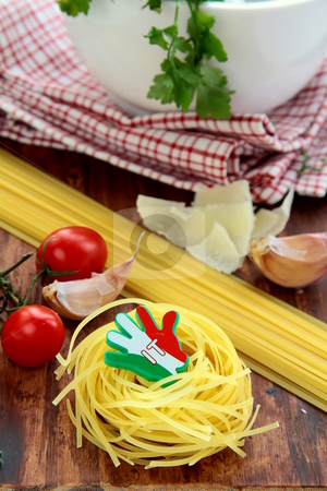 Different varieties of Italian pasta on a wooden board stock photo,  by Olga Kriger