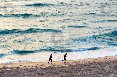 The sea at sunset stock photo, The waves of the Mediterranean Sea in the setting sun by Vladimir Blinov