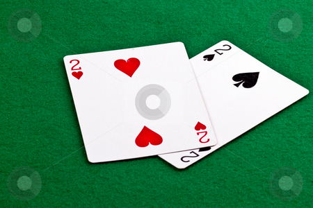 Pair of deuces stock photo, Poker hand with a pair of deuces on green felt by Gert Lavsen