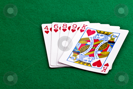 Flush of hearts stock photo, Poker hand with a flush of hearts on green felt by Gert Lavsen