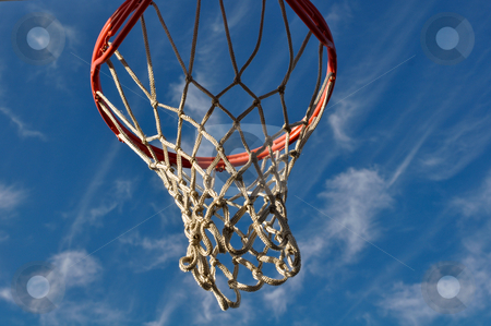 Basketball Hoop with Blue Sky and White Clouds stock photo, Basketball Hoop with Blue Sky and White Clouds by Brandon Bourdages