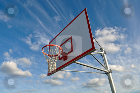Basketball Hoop with Clouds stock photo, Basketball Hoop with Clouds by Brandon Bourdages
