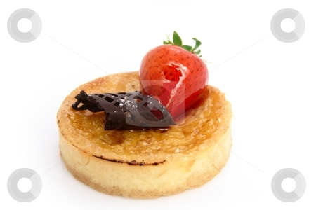 Baked Custard Tart stock photo, A delicious baked custard tart. Decorated with a strawberry and a chocolate curl. Shot on white by Martin Darley