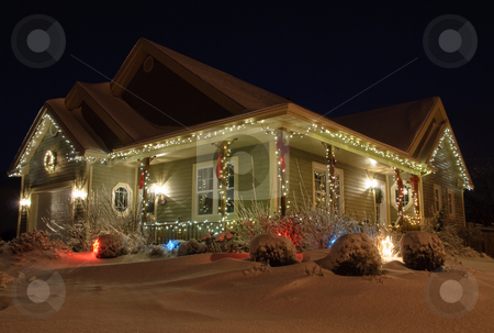 Christmas House with lights stock photo, Christmas House decorated with lights at night in Winter by Alain Turgeon