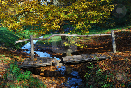 Wooden bridge and stream stock photo, The old wooden bridge over a stream in the countryside by zagart