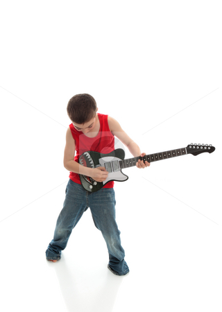 Little boy playing a guitar stock photo, A young boy plays a musical instrument.  White background. by Leah-Anne Thompson