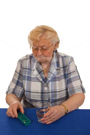 Taking pills stock photo, Elderly woman with medicine - isolated on white background by Birgit Reitz-Hofmann