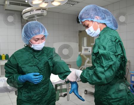 nurses wearing gloves stock photo