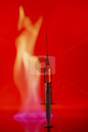 Injections stock photo, Syringe with a drug on a background of a  blue flame. by Sergey Goruppa