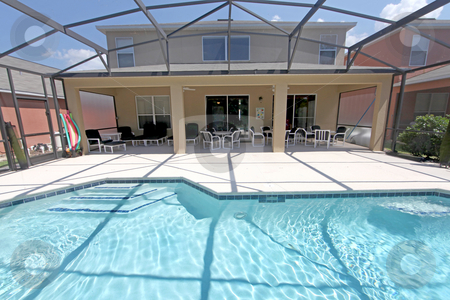 Pool and Lanai stock photo, A Back Exterior of a Florida Home with Pool and Lanai by Lucy Clark