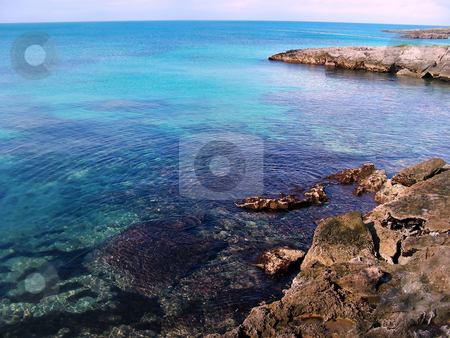 Rocky North Shore stock photo, The rocky north shore of Bermuda. There are an amazing number of variations of blue in the water. by Mary Lane