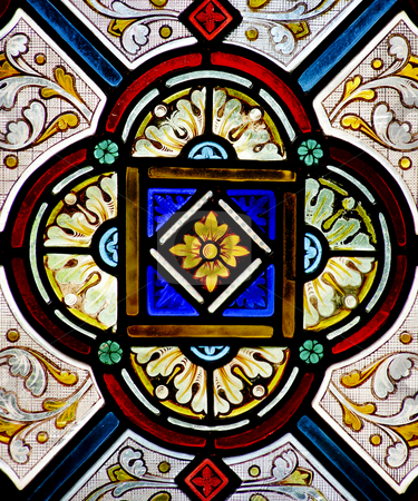 Stained Glass  stock photo, Pretty pattern in a stained glass window - a church in Cornwall, England. by Mary Lane