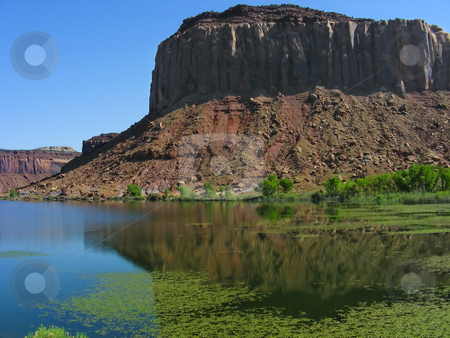 Mesa Reflections stock photo, A sandstone mesa reflection in the waters of a small river, near Canyonlands National Park, Moab, Utah. by Mary Lane