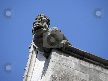 Winchester Gargyole stock photo, Fierce looking gargoyle on the side of the cathedral at Winchester, England. by Mary Lane