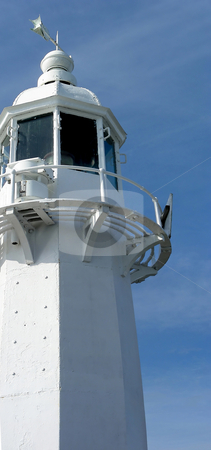 Cornish Lighthouse stock photo, A side view of a lighthouse on the pier at Mevagissey, Cornwall, England by Mary Lane