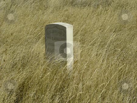 Wounded Knee stock photo, A gravestone amidst the prairie grass of Wounded Knee, Wyoming. by Mary Lane