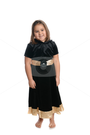 Five Year Old Girl stock photo, A full length view of a  cute five year old girl wearing a black dress, isolated against a white background by Richard Nelson