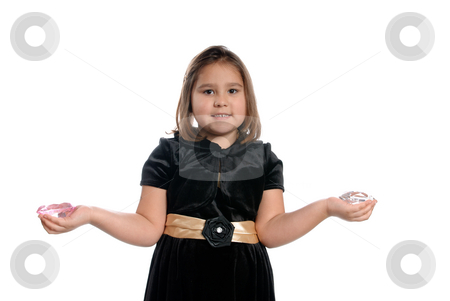 5 Year Old Girl stock photo, A 5 year old girl holding fake diamonds in her hands, isolated against a white background. by Richard Nelson