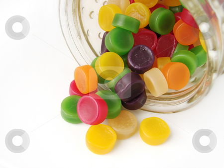 Wine gum confectionery stock photo, Wine gum sweets falling out of the jar, white background by suemack