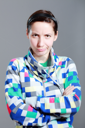Girl with expression stock photo, Girl with expression on her face, against grey background by Nikola Spasenoski