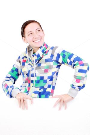 Girl with a panel stock photo, Happy girl holding white styrofoam, against white by Nikola Spasenoski
