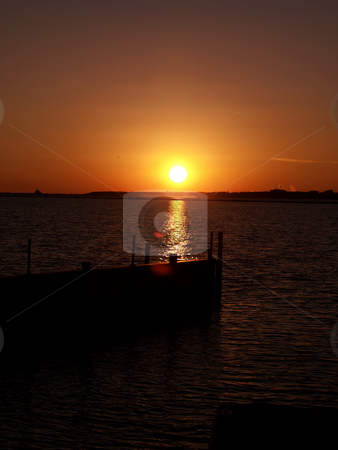 Golden sunset stock photo, The North Carolina Coast shown at night along the docks by Tim Markley