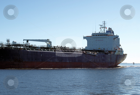 Large freghter stock photo, A large cargo vessel heading out to sea by Tim Markley