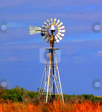 Windmill stock photo, Slightly lopsided windmill in abandoned field by Marburg