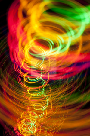 Light spiral stock photo, A spiral of vividly coloured lines of light on a black background by Stephen Gibson