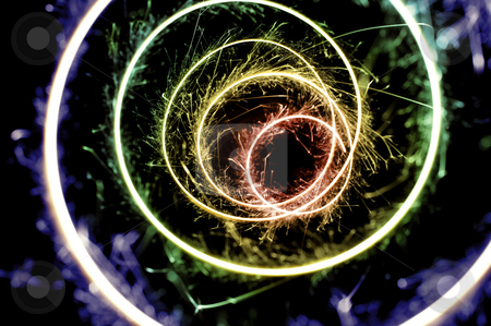 Rainbow spiral sparkles stock photo, A rainbow colored spiral of bright sparkling light by Stephen Gibson