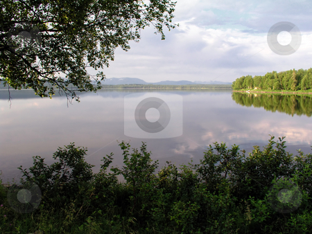 Beautiful and calm lake stock photo, Beautiful Landscape of calm lake in Sweden by Sasas Design