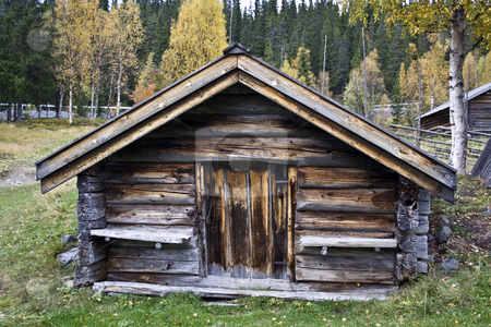 Old wood cabin stock photo, Old and traditional wood cabin in Sweden by Ingvar Bjork