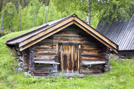 Old traditional wooden cabin  stock photo, Old traditional wooden cabin in Sweden by Ingvar Bjork