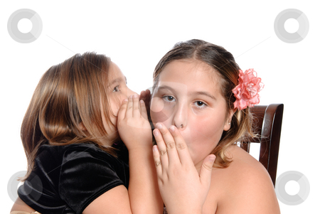Sister's Secret stock photo, A sister's secret is shocking to the older one, isolated against a white background. by Richard Nelson