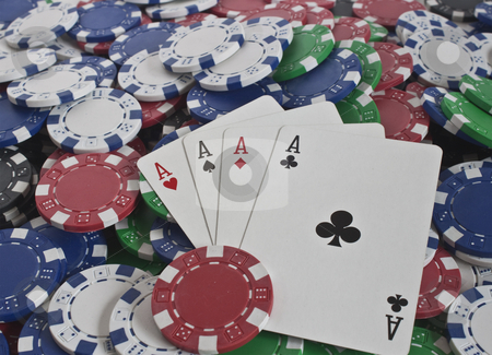 Four aces and poker chips stock photo, Loads of poker chips with winning hand of four aces by Stephen Clarke