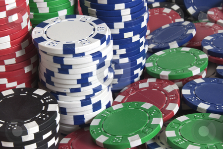 Pokerchips-closeup stock photo, Poker chips closeup - tower of white and blue by Stephen Clarke