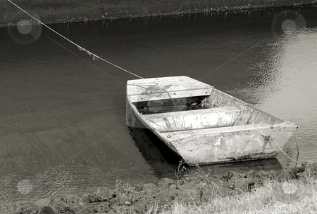 Flat boat stock photo, Old boat along the shore in very poor condition shown in black and white by Tim Markley
