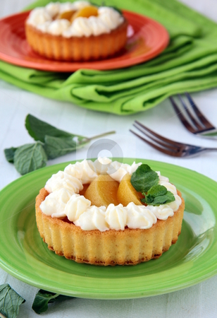 Mini cake with cream and peach in the basket stock photo,  by Olga Kriger