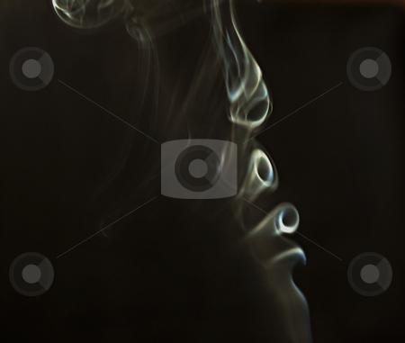 Smoke stock photo, White smoke flying over a black background by Fabio Alcini