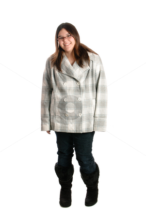 Smiling Teen Wearing Winter Clothing stock photo, A full body view of a smiling brunette teenage girl is posing while wearing winter clothing, isolated against a white background by Richard Nelson